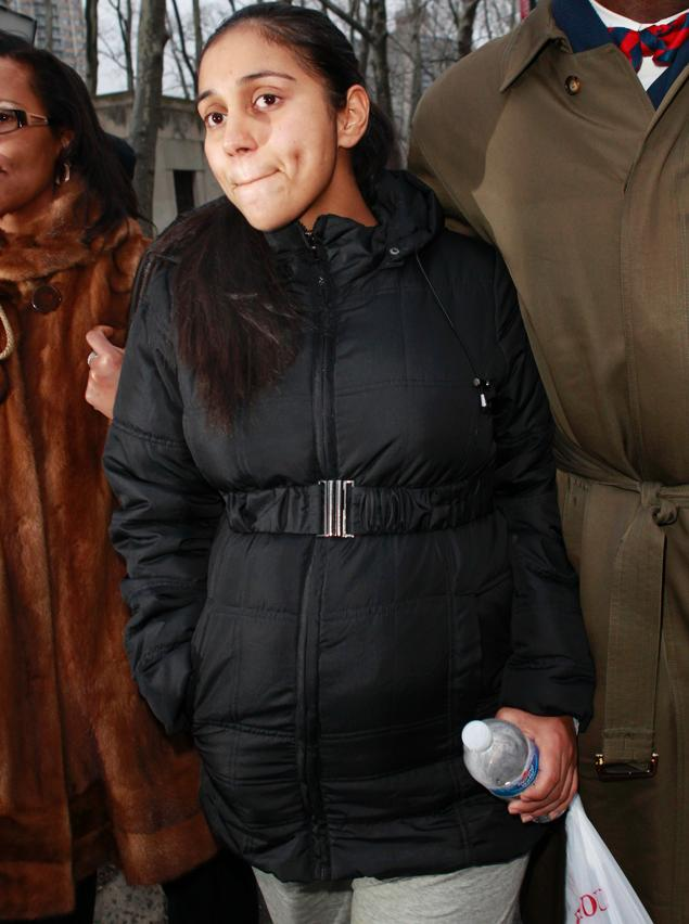 Corrections Officer Nancy Gonzalez, eight months pregnant by convicted cop killer Ronell Wilson, leaves Brooklyn Federal Court on Tuesday, February 5, 2013.